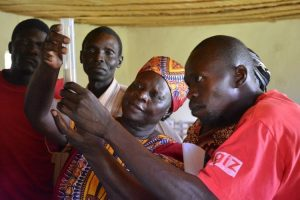 African adults examining results from a test tube