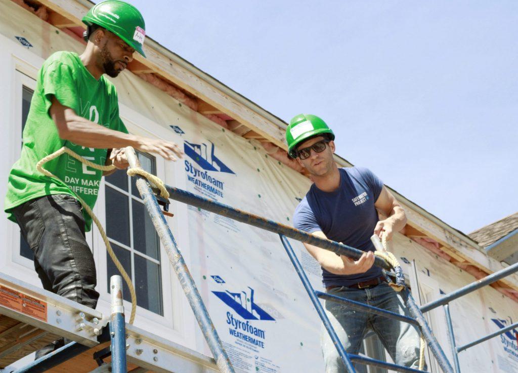 Dave erecting scaffolding at habitat build