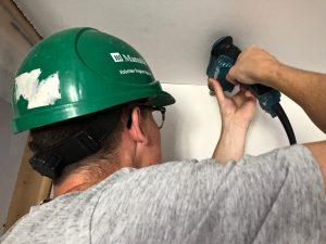Spencer installing drywall